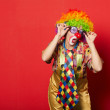 Funny clown with glasses on red — Stock Photo #32529603
