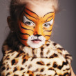 Stock Photo: Little girl with tiger costume