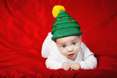 Little cute baby with christmas tree hat — Stock Photo