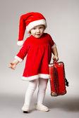 Little cute girl with christmas suitcase — Φωτογραφία Αρχείου