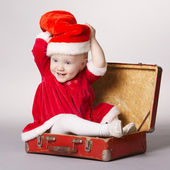 little happy girl with christmas suitcase — Stok fotoğraf