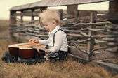 Cute little boy with guitar — Stock Photo