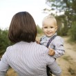 Little happy baby with mother — Stock Photo