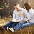 Happy family reading book — Stock Photo