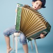Little funny accordion player — Stock Photo #36704021