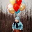 Little boy wants to fly on balloons — Stock Photo