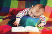 Cute little baby reading book — Stock Photo