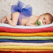 Newborn baby lying on colorful towels — Stock Photo #41082227