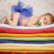 Newborn baby lying on colorful towels — Stock Photo #41084099