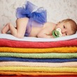 Newborn baby lying on colorful towels — Stock Photo