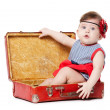 Baby with suitcase isolated on white — Stock Photo