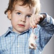 Boy plays with mouse — Stock Photo