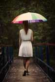 Girl portrait with colorful umbrella — Stock Photo