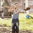 Happy boy working with shovel in garden — Stock Photo #42849325