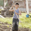 Happy boy working with shovel in garden — Stock Photo