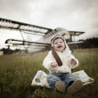 Sweet baby dreaming of being pilot — Stock Photo #43033291