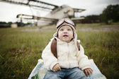 Sweet baby dreaming of being pilot — Stock Photo