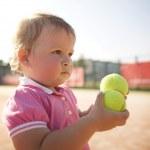 Little girl plays tennis — Stock Photo #43678867