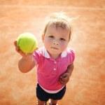 Little girl plays tennis — Stock Photo #43678873