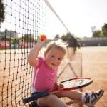 Little girl plays tennis — Stock Photo #43678883