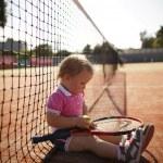 Little girl plays tennis — Stock Photo #43678889
