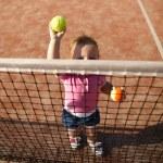Little girl plays tennis — Stock Photo #43678919