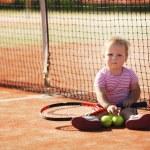 Little girl plays tennis — Stock Photo #43678943