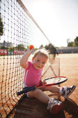 Little girl plays tennis — Stock Photo
