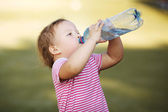 Girl with bottle of mineral water — Stock Photo