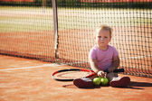Little girl plays tennis — Stock Photo