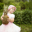 Sweet funny girl with pineapple — Stock Photo #44147581