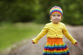 Little girl greets hands up — Stock Photo