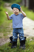 Funny little boy in uniform — Stock Photo