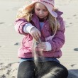Foto Stock: Girl in sand