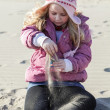 Stock Photo: Girl in sand