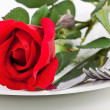 Royalty-Free Stock Photo: Close up of red rose, plate and cutlery