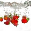 Stock Photo: Strawberries falling into water