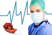 Female surgeon with heart — Stock Photo