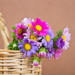 Basket brown with colourful flowers — ストック写真