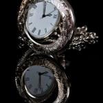 Pocket watch reflection — Stock Photo #22759406