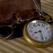 Royalty-Free Stock Photo: Pocket watch and glasses