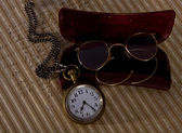 Pocket watch and glasses — Stock fotografie