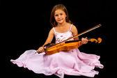 Girl holding violin in pink dress — Stock Photo