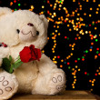Teddie bear with white with red rose sitting — Stock Photo #26574111