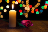Candle light closeup with bokeh and flower — Zdjęcie stockowe