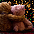 Two Teddie bear sitting holding bokeh background — Stock Photo #27213289