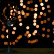 Wine glass on wooden table with dark and bokeh background — Stock Photo
