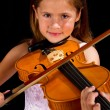 Girl playing violin in pink dress — Stock Photo