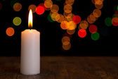 Candle light closeup with bokeh white — Stock Photo