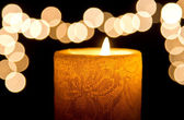 Candle light closeup with bokeh — Stock Photo
